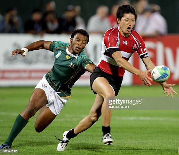 South Africa's Mpho Mbiyozo vies with Shinichi Yokoyama of Japan during their match on the opening day of the Dubai Rugby Sevens tournament in the...