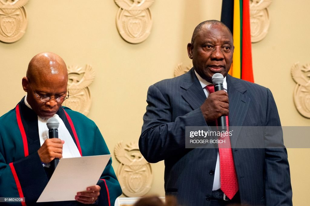 South Africa's new president Cyril Ramaphosa delivers a speech as he is sworn into office by South Africa's Chief Justice Mogoeng Mogoeng (L) after being elected by the Members of Parliament at the Parliament in Cape Town, on February 15, 2018. South African lawmakers elected wealthy former businessman Cyril Ramaphosa on February 15, 2018 as the country's new president after scandal-tainted Jacob Zuma resigned under pressure from his own ANC ruling party. Ramaphosa was elected without a vote after being the only candidate nominated in the parliament in Cape Town, chief justice Mogoeng Mogoeng told assembled lawmakers. PHOTO / POOL / Rodger BOSCH