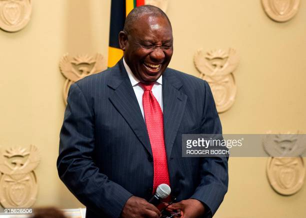 South Africa's new president Cyril Ramaphosa reacts as he is sworn into office after being elected by the Members of Parliament at the Parliament in...