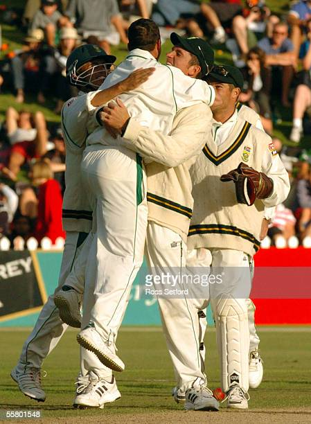 South Africa's Nick Boje centre is hugged by team mates Jacques Rudolph left and Martin van Jaarsveld after bowling New Zealand's Brendon McCullum...