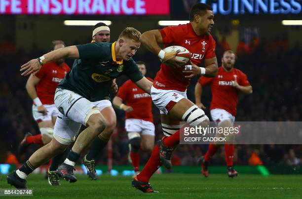 South Africa's number 8 Dan du Preez tackles Wales' number 8 Taulupe Faletau during the international rugby union test match between Wales and South...