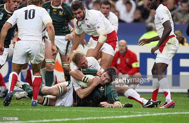 South Africa's number 8 Danie Rossouw vies with England's flanker Lewis Moody during the rugby union World Cup final match England vs. South Africa,...