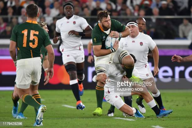 South Africa's number 8 Duane Vermeulen holds onto the ball during the Japan 2019 Rugby World Cup final match between England and South Africa at the...