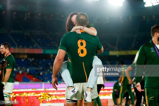 South Africa's number 8 Duane Vermeulen is kissed as the team celebrates winning the Japan 2019 Rugby World Cup final match between England and South...