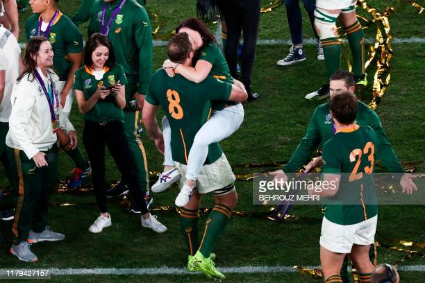 South Africa's number 8 Duane Vermeulen is kissed as they celebrate winning the Japan 2019 Rugby World Cup final match between England and South...