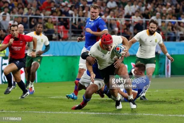 South Africa's number 8 Schalk Brits scores a try during the Japan 2019 Rugby World Cup Pool B match between South Africa and Namibia at the City of...