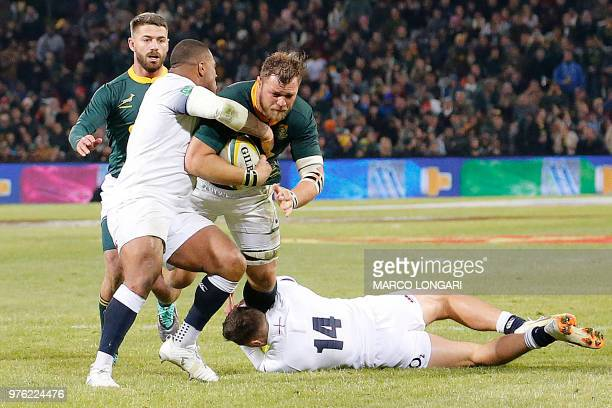 South Africa's number eight Duane Vermeulen is tackled during the second test match South Africa vs England at the Free State Stadium in Bloemfontein...