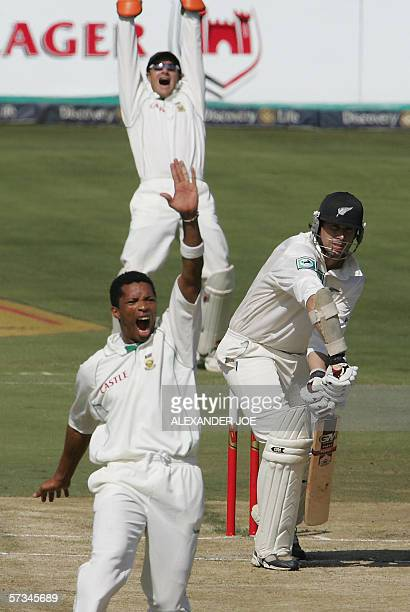 South Africa's opening bowler Makhaya Ntini celebrates after bowling and courting out New Zealand batsman Stephen Fleming for runs on day Two of the...
