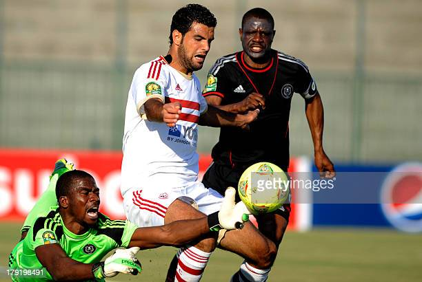 South Africa's Oralando Pirates goalkeeper Senzo Robert Meyima catches the ball in front of Egypt's Zamalek player Ahmad Fathy as Lucky Letlhohonolo...