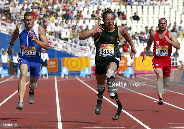 South Africa's Oscar Pistorius , French Andre and Austria's Linhart run at semi-final of the Men's 100m - T44 during the 12th Paralympic Games at the...
