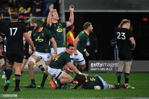 TOPSHOT South Africa's PieterSteph du Toit Franco Mostert Jesse Kriel and Warren Whiteley celebrate their victory during the Rugby Championship match...