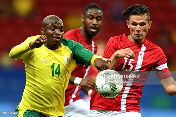 Gift motupa stock photos and pictures getty images south africas player gift motupa vies for the ball with denmarks pascal gregor during their rio negle Images