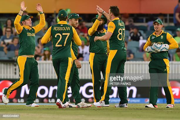 South Africa's players celebrate a wicket during the 2015 Cricket World Cup Pool B match between Ireland and South Africa in Canberra on March 3 2015...