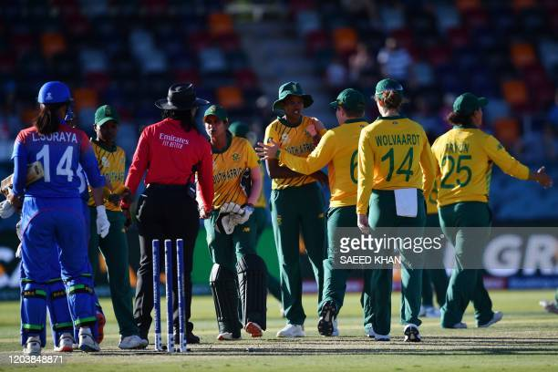 South Africa's players celebrate after a victory against Thailand during the Twenty20 women's World Cup cricket match between South Africa and...