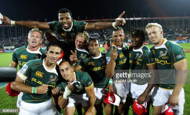 South Africa's players celebrate after beating England in their IRB World Sevens Series final match on the last day of the Rugby Sevens tournament in...