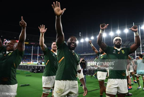 TOPSHOT South Africa's players celebrate winning the Japan 2019 Rugby World Cup semifinal match between Wales and South Africa at the International...
