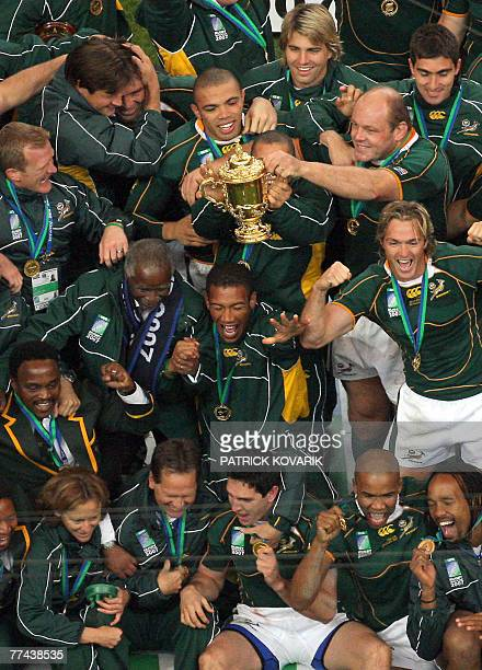 South Africa's players celebrates with the William Webb Ellis cup after winning the rugby union World Cup final match England vs South Africa 20...
