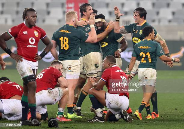 South Africa's players including South Africa's blindside flanker and captain Siya Kolisi celebrate after victory in the third rugby union Test match...