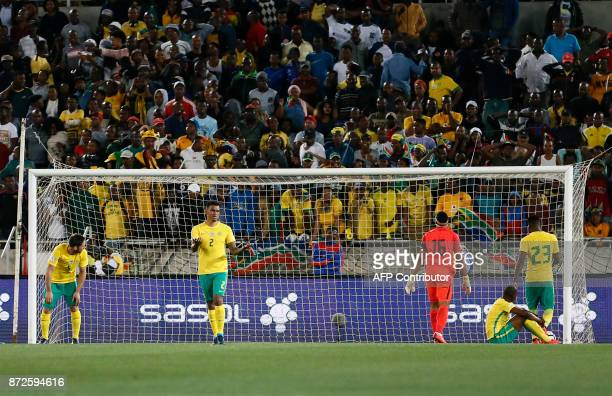 South Africa's players react during the FIFA 2018 World Cup Africa Group D qualifying football match between South Africa and Senegal at The Peter...