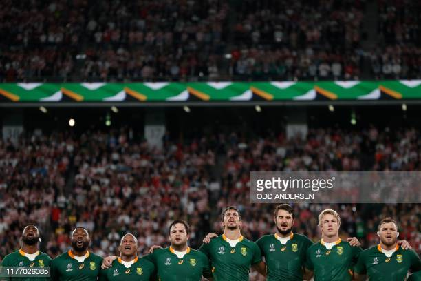 South Africa's players sing the national anthem before the Japan 2019 Rugby World Cup quarter-final match between Japan and South Africa at the Tokyo...