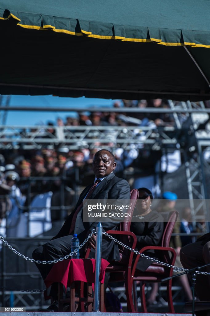 South Africa's President Cyril Ramaphosa watches the South African National Defense Force (SANDF) during a day of Armed Forces on February 21, 2018 in Kimberley South Africa. /