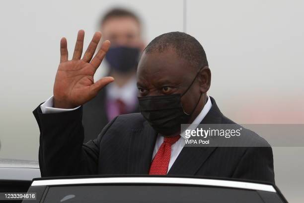 South Africa's President Cyril Ramaphosa waves as he arrives at Newquay Airport on June 11, 2021 in Newquay, England. UK Prime Minister, Boris...