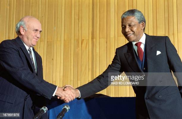 South Africa's President FW de Klerk and antiapartheid leader and African National Congress member Nelson Mandela shake hands on May 04 1990 at a...
