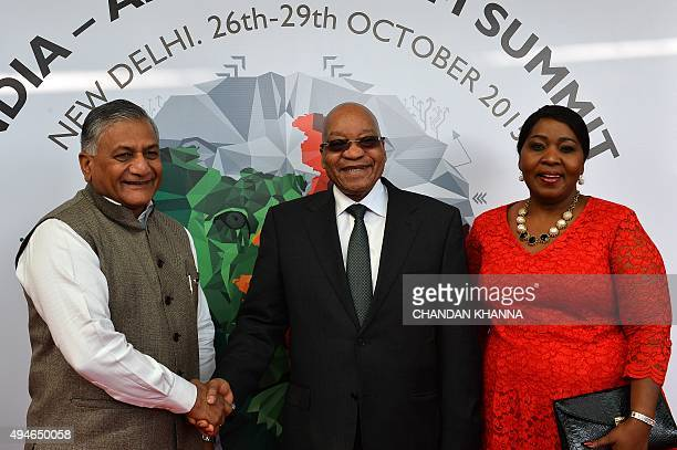 South Africa's President Jacob Zuma and his wife Gloria Bongi Ngema are welcomed by India's External Affairs Minister Vijay Kumar Singh upon his...