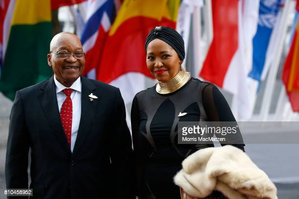 South Africa's President Jacob Zuma and his wife Thobeka MadibaZuma arrive to attend a concert at the Elbphilharmonie philharmonic concert hall on...