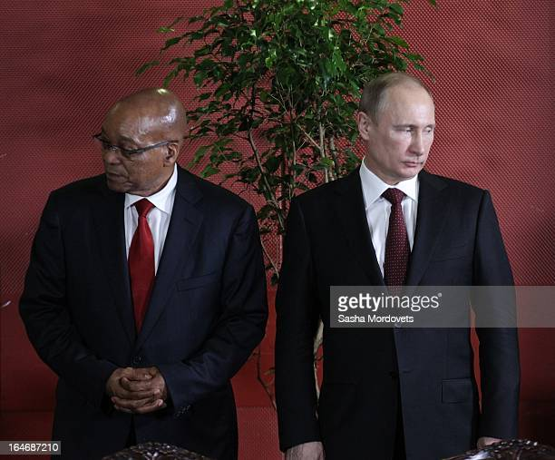 South Africa's President Jacob Zuma attends a meeting with Russian President Vladimir Putin March 26, 2013 in Durban, South Africa. Putin traveled to...