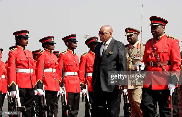 South Africa's President Jacob Zuma inspects a military parade on arrival at Kamuzu International Airport in Lilongwe on August 16 ahead of the 33rd...