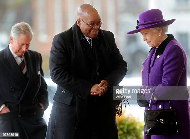 South Africa's President Jacob Zuma is greeted by Queen Elizabeth II during a ceremonial welcome at Horseguards Parade on March 3, 2010 in London,...