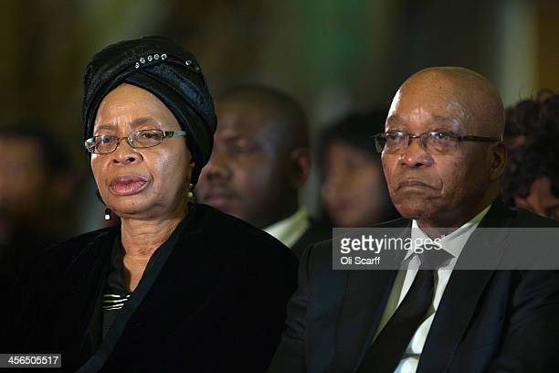 South Africa's President Jacob Zuma sits with Graca Machel widow of Nelson Mandela during an African National Congress led alliance send off ceremony...