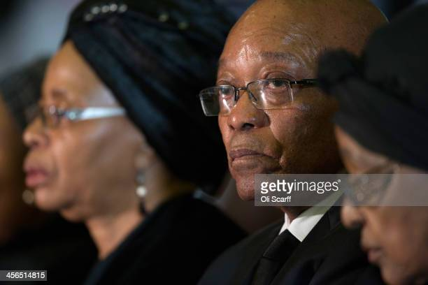 South Africa's President Jacob Zuma sits with Graca Machel , widow of Nelson Mandela, and Winnie Mandela former wife of Nelson Mandela during an...