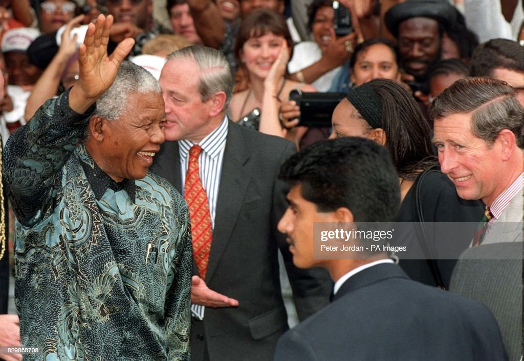 South Africa's President Nelson Mandela acknowledges the cheers of the vast crowds which turned up to see him during his visit to the Brixton Recreation Centre in south London this morning (Fri). The Prince of Wales (R) accompanied the President to Brixton on the final day of his state visit to Britain. See PA story MANDELA Visit. Photo by Peter Jordan/PA.