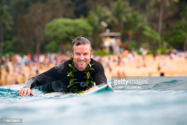 South Africa's pro surfer Grant Baker takes part in the opening ceremony of the 2019 Eddie Aikau Big wave Invitational Surfing Event at Waimea Bay on...