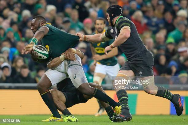 South Africa's prop Tendai Mtawarira is tackled by Ireland's flanker Sean O'Brien during the rugby union international Test match between Ireland and...