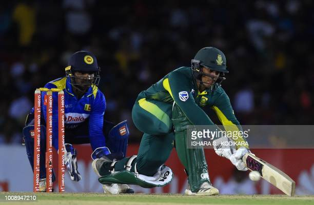 South Africa's Quinton de Kock plays a shot as Sri Lanka's Kusal Perera looks on during the second oneday international cricket match between Sri...