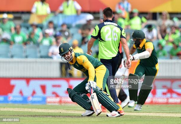 South Africa's Quinton de Kock runs between the wickets during the 2015 Cricket World Cup Pool B match between Ireland and South Africa in Canberra...