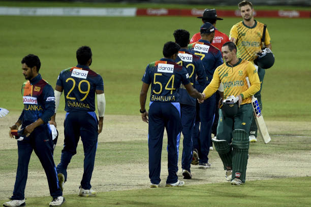 South Africa's Quinton de Kock shakes hands with Sri Lanka's Bhanuka Rajapaksa after South Africa won by 9 wickets in the second international...