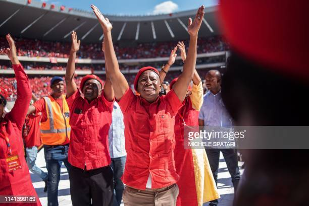 South Africa's radical left Economic Freedom Fighters opposition party leader Julius Malema acknowledges the crowd at the Orlando Stadium in Soweto,...