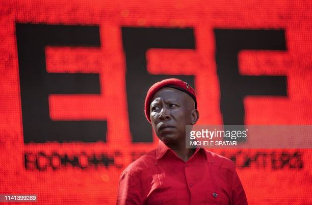 South Africa's radical left Economic Freedom Fighters opposition party leader Julius Malema overlooks the crowd at the Orlando Stadium in Soweto,...