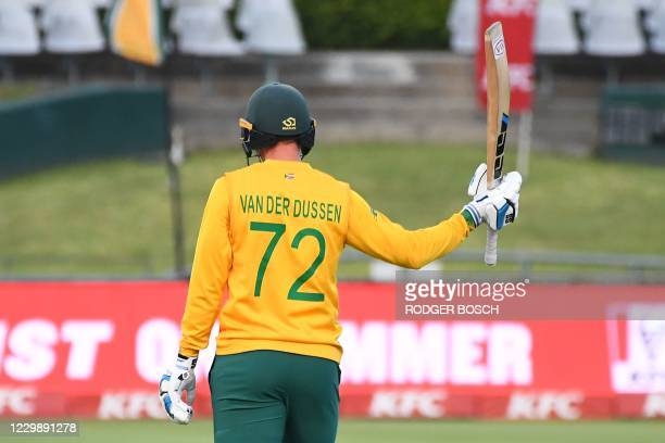 South Africa's Rassie van der Dussen celebrates after scoring a half-century during the third T20 international cricket match between South Africa...