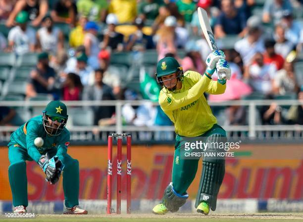 South Africa's Rassie van der Dussen is watched by Pakistan's wicketkeeper Mohammad Rizwan as he plays a shot during the second T20 cricket match...