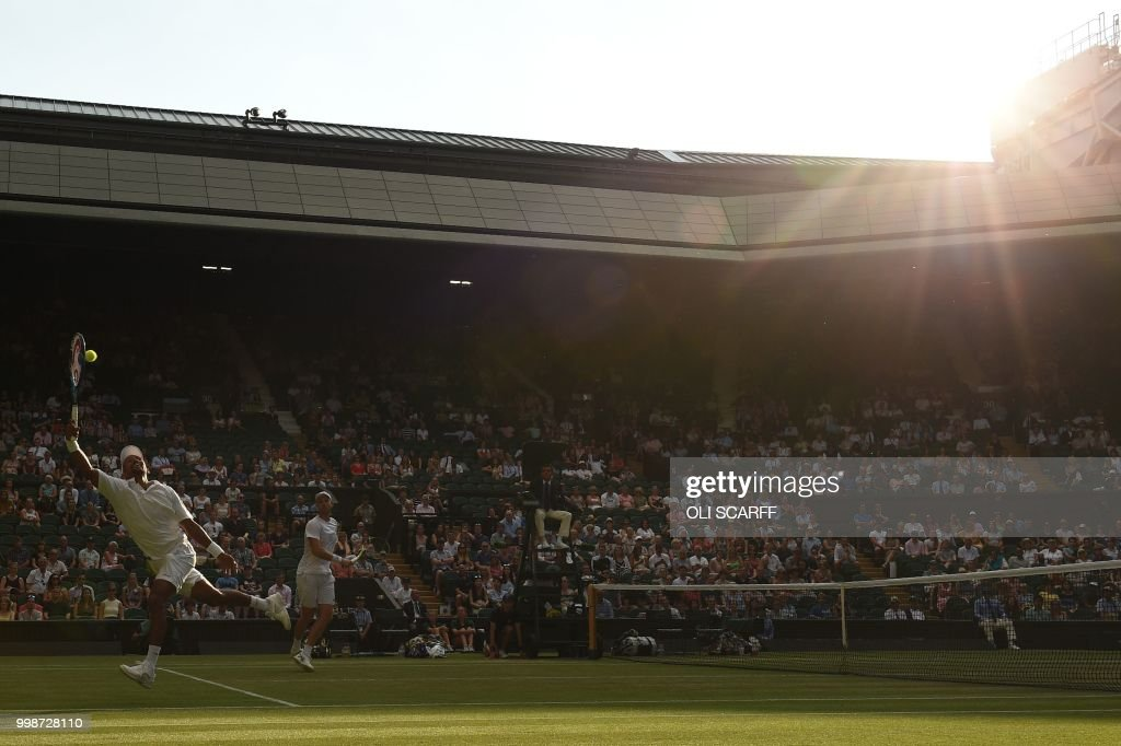 South Africa's Raven Klaasen and New Zealand's Michael Venus return to US player Mike Bryan and US player Jack Sock during their mens' doubles final match on the twelfth day of the 2018 Wimbledon Championships at The All England Lawn Tennis Club in Wimbledon, southwest London, on July 14, 2018. (Photo by Oli SCARFF / AFP) / RESTRICTED
