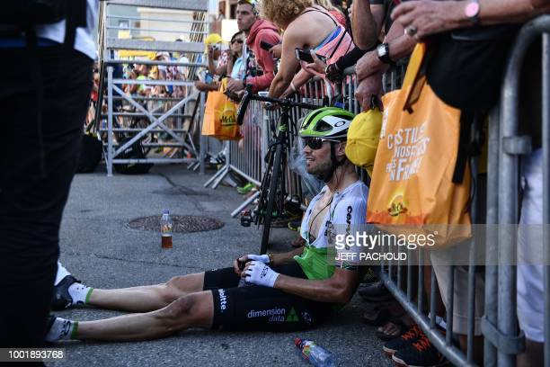 South Africa's Reinardt Janse Van Rensburg catches his breath after he crossed the finish line of the twelfth stage of the 105th edition of the Tour...