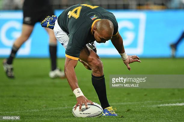 South Africa's right wing Cornal Hendricks scores a try during the Rugby Championship Test between New Zealand and South Africa at Westpac Stadium on...