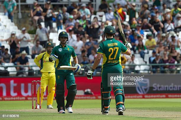 South Africa's Rilee Rossouw celebrates his 50th run for South Africa as teammate JeanPaul Duminy congratulates him during the One Day International...