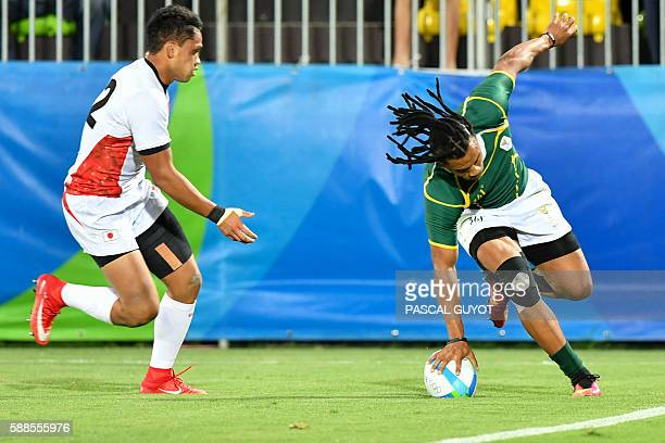 South Africa's Rosko Speckman scores a try in the mens rugby sevens bronze medal match between Japan and South Africa during the Rio 2016 Olympic...