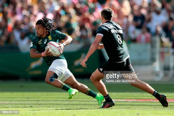 South Africa's Rosko Specman breaks through past New Zealand's Andrew Knewstubb during their semifinal match on the second day of the World Rugby...